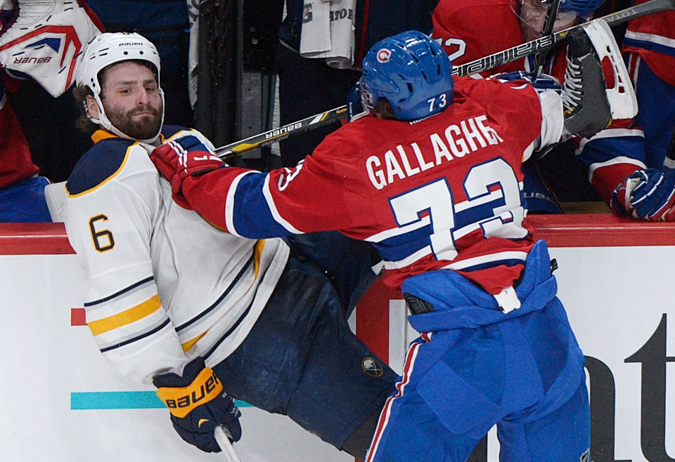 Montreal Canadiens' Brendan Gallagher checks Buffalo Sabres' Mike Weber into the boards during third period NHL hockey action in Montreal, Saturday, February 2, 2013. THE CANADIAN PRESS IMAGES/Graham Hughes