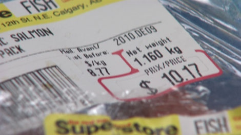 A CTV News hidden-camera investigation revealed a Coquitlam Real Canadian Superstore employee re-wrapping fish with a new best-before date. Jan. 4, 2011. (CTV)