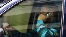 A driver talks on his cell phone while making his way through downtown Ottawa, Ont., Wednesday September 30, 2009. Ontario's ban on the use of cellphones, BlackBerrys and other hand-held electronic devices by drivers will take effect Oct. 26, 2009. THE CANADIAN PRESS/Sean Kilpatrick