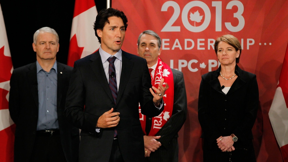 Liberal party candidate Justin Trudeau speaks while Marc Garneau, David Bertschi and Martha Hall Findlay listen at the Liberal Party of Canada Leadership debate in Winnipeg on Saturday, Feb. 2, 2013. (John Woods / THE CANADIAN PRESS)