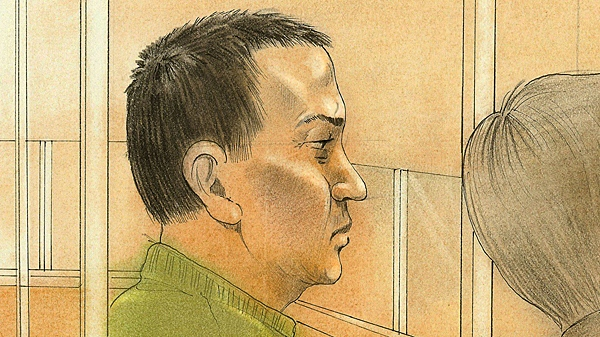 Bao Mac watches court proceedings in Newmarket on Tuesday, Jan. 4, 2011.