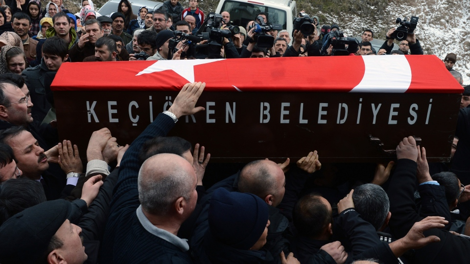 People carry a Turkish flag-covered coffin of Mustafa Akarsu, an embassy security guard killed when a suicide bomber struck the American Embassy in Turkish capital on Friday, during his funeral in Ankara, Turkey, Saturday, Feb. 2, 2013. (AP Photo)