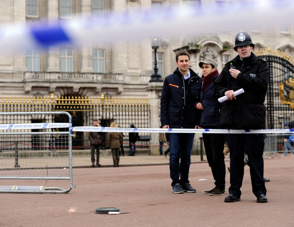A cornered-off area containing knives, a hat and Taser wire outside Buckingham Palace is shown in central London after a man armed with two knives was stunned by police on Feb. 3, 2013. (AP / Jonathan Brady)