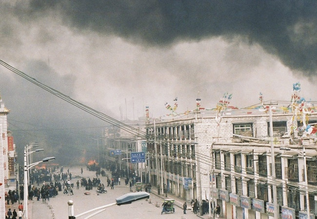 Tibetan protesters burn motorcycles, cycles and goods from shops belonging to Chinese residents as they give vent to their frustration and anger against Chinese rule in Lhasa, China on March 14, 2008, made available Thursday, March 20, 2008. (AP /Jonathan Brady)