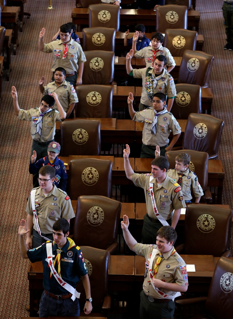 Boy Scouts recite the Scout Oath during the annual Boy Scouts Parade and Report to State in the House Chambers at the Texas capitol, in Austin, Texas in this photo taken Feb. 2, 2013.(AP / Eric Gay)