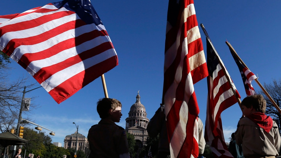 Boy Scouts carry U.S. flags up Congress Avenue towards the Texas Capitol during the annual Boy Scouts Parade and Report to State in in Austin, Texas on Saturday, Feb. 2, 2013. (AP / Eric Gay)