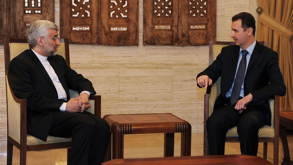 In this photo released by the Syrian official news agency, SANA, Syrian President Bashar Assad, right, meets with Iran's Chief nuclear negotiator Saeed Jalili, in Damascus, Syria, Sunday, Feb. 3, 2013. (AP / SANA)