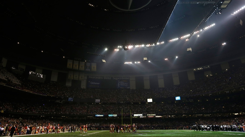 Players huddle on the field during a Superdome power outage in the second half of the NFL Super Bowl XLVII football game between the San Francisco 49ers and the Baltimore Ravens in New Orleans on Sunday, Feb. 3, 2013. (AP / Mark Humphrey)