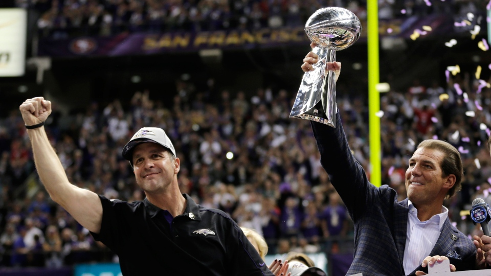 Baltimore Ravens owner Stephen J. Bisciotti, right, holds up the Vince Lombardi Trophy as he and head coach John Harbaugh celebrate the team's 34-31win against the San Francisco 49ers in the NFL Super Bowl XLVII football game in New Orleans on Sunday, Feb. 3, 2013. (AP / Matt Slocum)