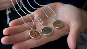 Renee Gruszecki displays jewelry she designs from coins at her studio, Coin Coin designs & co., in Halifax on Saturday, Feb. 2, 2013. (Andrew Vaughan / THE CANADIAN PRESS)
