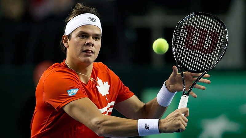 Canada's Milos Raonic, of Toronto, Ont., drops the ball over the net for a point against Spain's Guillermo Garcia-Lopez during a Davis Cup tennis world group first-round tie singles match in Vancouver, B.C., on Sunday February 3, 2013. (Darryl Dyck / THE CANADIAN PRESS)