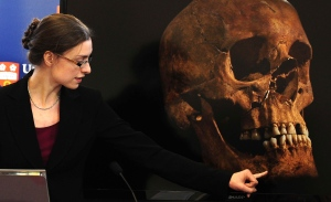 Jo Appleby, a lecturer in Human Bioarchaeology, at University of Leicester, School of Archaeology and Ancient History, who led the exhumation of the remains found during a dig at a Leicester car park, speaks at the university Monday, Feb. 4, 2013. (AP / Rui Vieira)
