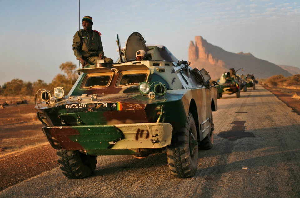 A convoy of Malian troops makes a stop to test some of their weapons near Hambori, northern Mali, on the road to Gao, Monday Feb. 4, 2013. (AP / Jerome Delay)