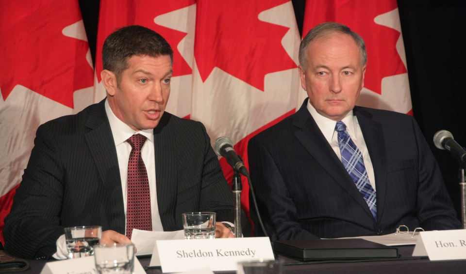 Former NHLer Sheldon Kennedy (left) speaks at a news conference with Justice Minister Rob Nicholson in Toronto on Monday, Feb. 4, 2013. Nicholson announced government plans to stiffen penalties for child-sex offenders and create a victims bill of rights. (Colin Perkel /  THE CANADIAN PRESS)