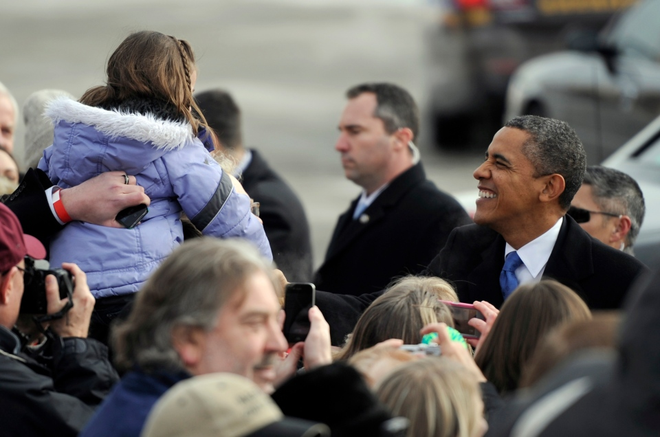 U.S. President Barack Obama shakes hands with military family members upon his arrival on Air Force One at the Minneapolis St. Paul Airport, Air Reserve Station in St. Paul, Minn., on Feb. 4, 2013. (AP Photo/Hannah Foslien)