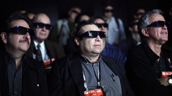 Members of the media wear 3-D glasses as they watch movie clips at the Panasonic 3-D full HD plasma theatre at the International Consumer Electronics Show in Las Vegas in this Jan. 7, 2009 file photo. (The Associated Press / Jae C. Hong)
