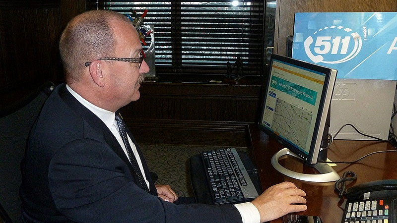 Transportation Minister Ric McIver demonstrates how to use the province's new official road reports service: 511. SUPPLIED.