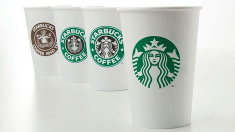 In this undated product image provided by Starbucks, the company's new 40-year anniversary logo is seen on a cup at right. Other cups bearing the company's logo from over the years, from left, 1971, 1987, and 1992, are also shown. (AP Photo/Starbucks)