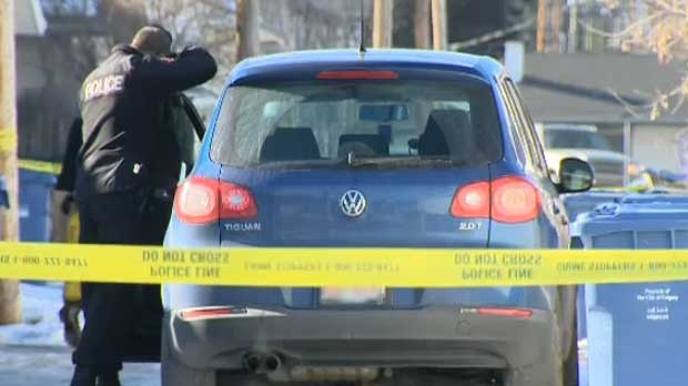A body was found slumped in a car in an alley in the 100 block of 28 Ave N.E