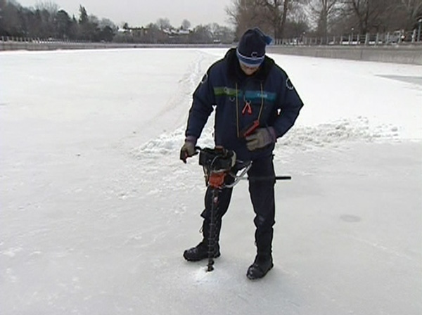 Crews measure the thickness of the Rideau Canal at the Pretoria Bridge, Thursday, Jan. 6, 2011.