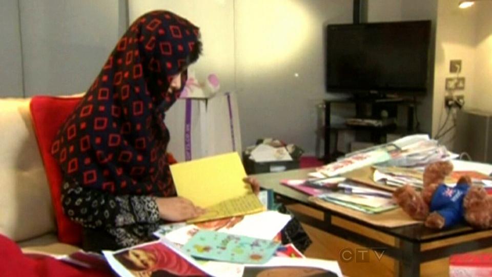 Malala Yousufzai reads cards from well-wishers in Birmingham, U.K., Jan. 22, 2013.