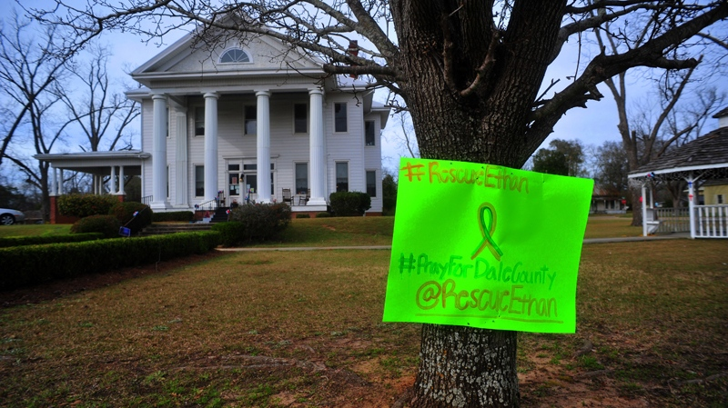 A sign posted on a tree in front of the Midland City Town Hall on Monday, Feb. 4, 2013 asks for prayers and a safe rescue for the boy named Ethan who was taken hostage and freed on Feb. 4, 2013. (AP Photo/The Dothan Eagle, Jay Hare)