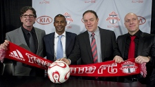 Toronto FC's newly-appointed management team of technical director Paul Mariner (left), head coach and technical director Aron Winter (centre left), and irst assistant coach Bob de Klerk (far right)  pose for a photo with Maple Leaf Sports Entertainment's Chief Operating Officer Tom Anselmi at a press conference in Toronto on Thursday, Jan. 6, 2011. (THE CANADIAN PRESS/Chris Young)