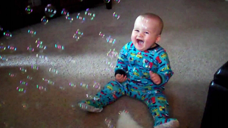 A baby is shown in this undated photo laughing at bubbles.