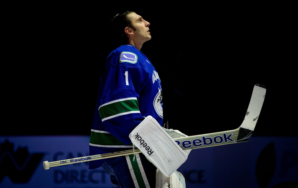 Vancouver Canucks' goalie Roberto Luongo looks on during the singing of 'O Canada' during an NHL hockey game in Vancouver, B.C., on Jan. 20, 2013. (Darryl Dyck / THE CANADIAN PRESS)