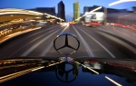 In this April 7, 2009 file photo, the star emblem on the hood of a Mercedes-Benz car produced by Daimler is seen near Potsdam Square, Potsdamer Platz, in Berlin. (AP / Gero Breloer)