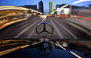 The star emblem on the hood of a Mercedes-Benz car produced by Daimler is seen near Potsdam Square, Potsdamer Platz, in Berlin on April 7, 2009. (AP / Gero Breloer)