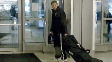 Russian team officials leave Buffalo Niagara International Airport in Cheektowaga, N.Y. after being forced to take a later flight, Thursday, Jan. 6, 2011.