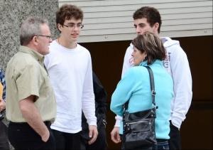 David MacNeil, an unidentified young man, David MacNeil Jr. and Donna MacNeil speak outside a courthouse in Hamilton, Bermuda on Monday, Feb. 4, 2013. (The Royal Gazette / Akil Simmons)