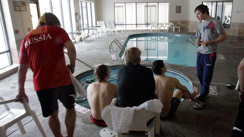 Russia's Artemi Panarin, right, talks with teammates relaxing in a hot tub at a hotel across the street from Buffalo Niagara International Airport in Cheektowaga, N.Y., Thursday, Jan. 6, 2011. (AP / David Duprey)