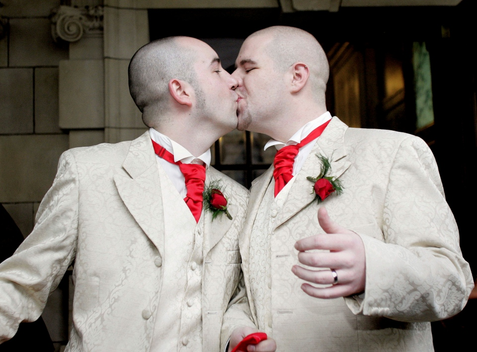 Henry Edmont Cane, left, and partner Christopher Patrick Flanaghan kiss outside Belfast's City Hall in Northern Ireland in this 2005 file photo. (AP / Peter Morrison)