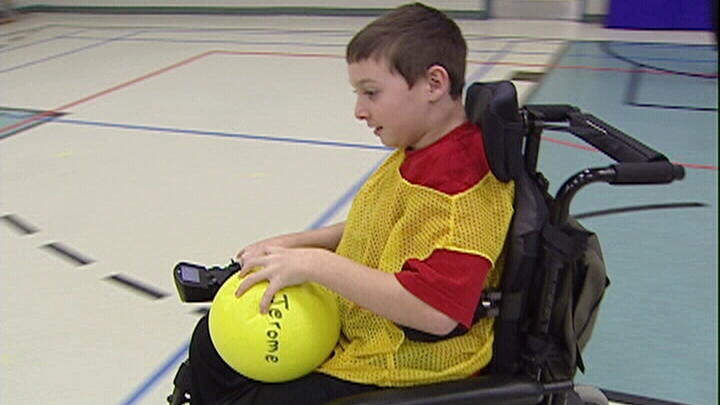 Kellen Schleyer tries out for the hand-ball team at his elementary school.