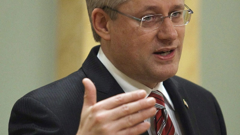 Prime Minister Stephen Harper gestures during his speech following a cabinet shuffle ceremony at Rideau Hall in Ottawa on Tuesday, January 4, 2011. (THE CANADIAN PRESS/Pawel Dwulit)