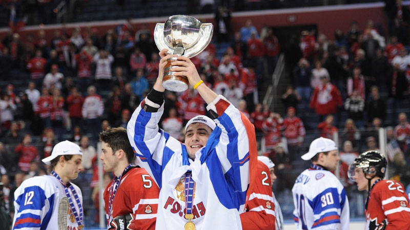 Team Russia forward Vladimir Tarasenko hoists the trophy after defeating Team Canada at the IIHF World Junior Championship gold medal final in Buffalo, N.Y. on Wednesday, January 5, 2011. (Nathan Denette / THE CANADIAN PRESS)