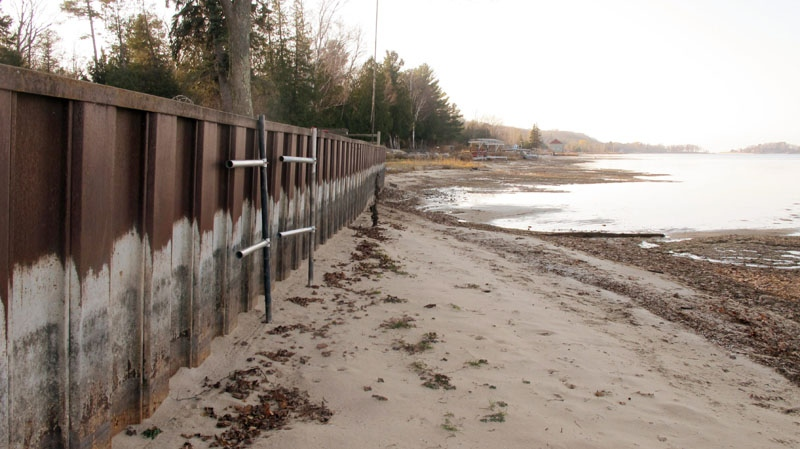 The white streaks on a steel breakwall show the normal water level on Portage Lake at Onekama, Mich., which is connected by a channel to Lake Michigan, Nov. 16, 2012. (AP / John Flesher)