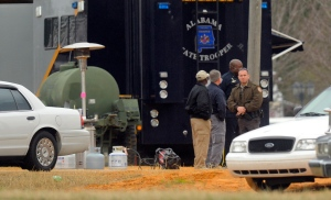 FBI and other personnel process the crime scene a day after a police raid left Jimmy Lee Dykes dead in Midland City, Ala. Tuesday, Feb. 5, 2013. (al.com / Joe Songer)