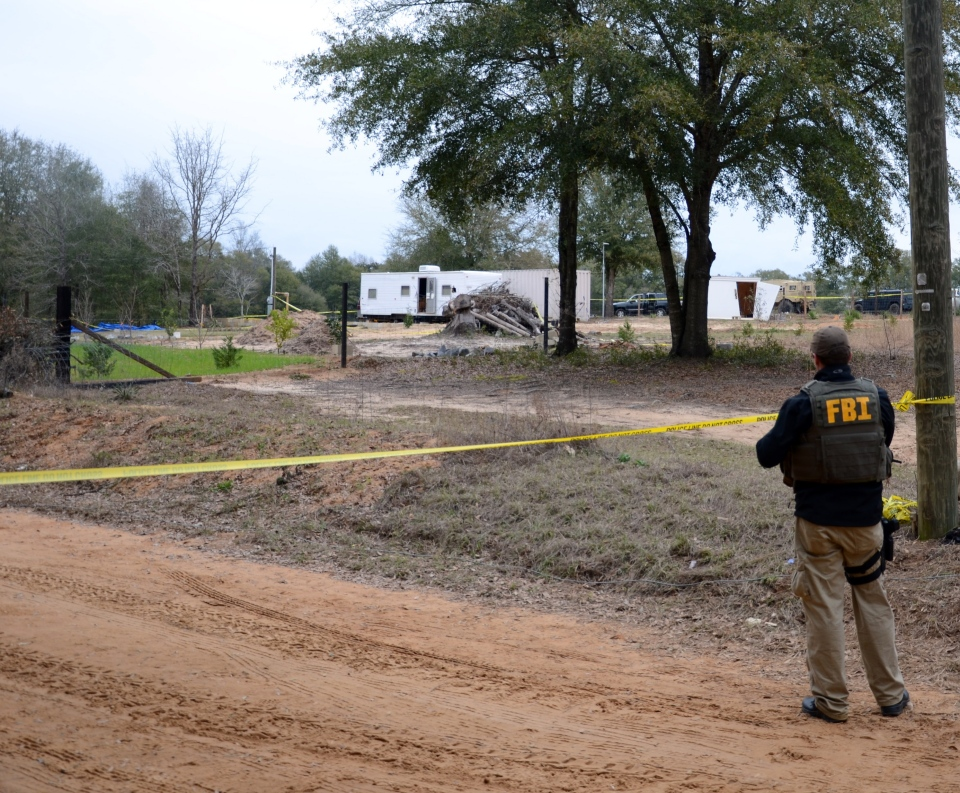 In this undated photo released by the FBI on Tuesday, Feb. 5, 2013, FBI agents and Dale County Sheriff's deputies secure the residence where a 5-year-old child was rescued after being held hostage for almost one week by Jimmy Lee Dykes, in Midland City, Ala. (AP / FBI)