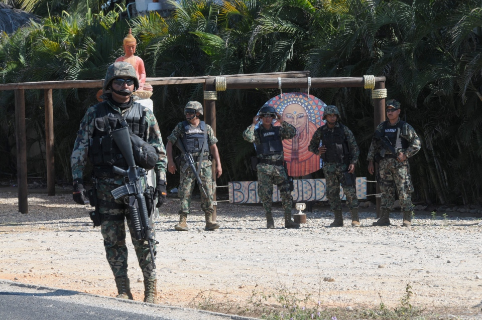 Mexican navy marines stand at a roadblock due to stepped up security after masked armed men broke into a beach home, raping six Spanish tourists who had rented the house in Acapulco, Mexico, Tuesday, Feb. 5, 2013. (AP / Bernandino Hernandez)