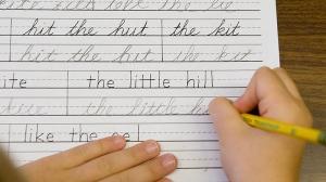 Child practices cursive writing