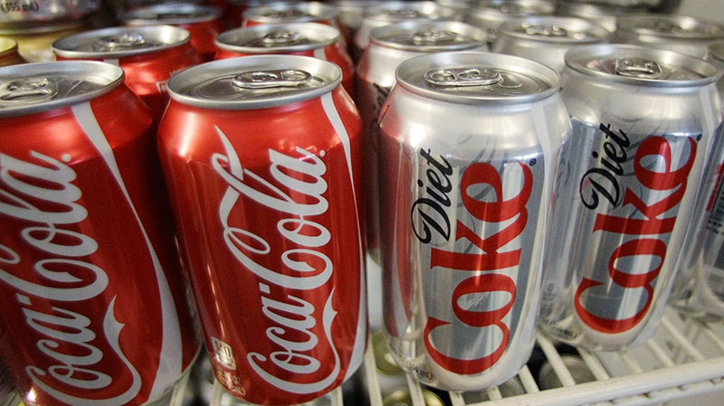 Cans of Coca-Cola and Diet Coke are shown in a cooler in Anne's Deli Thursday, March 17, 2011, in Portland, Ore. (AP)