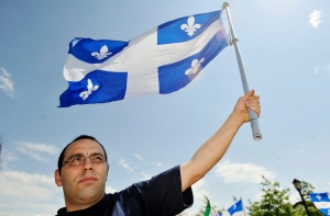 A protestor holds up a Quebec flag at a rally in Montreal in this 2009 file photo. (Graham Hughes/THE CANADIAN PRESS)