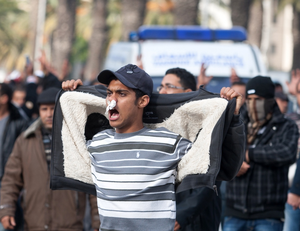 A demonstrator shouts near the ambulance carrying the body of opposition leader Chokri Belaid in Tunis, Wednesday, Feb. 6, 2013. (AP / Amine Landoulsi)