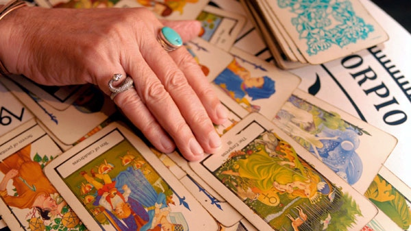 Psychic and Tarot card reader Otis Biggs reads a spread of Tarot cards on Friday, Aug. 10, 2007, in the French Quarter of New Orleans.