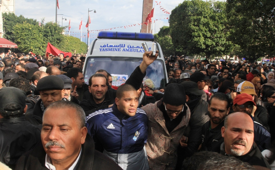 Protesters surround the ambulance carrying the body of Chokri Belaid after he was shot to death in Tunis, Wednesday, Feb. 6, 2013. (AP / Amine Landoulsi)