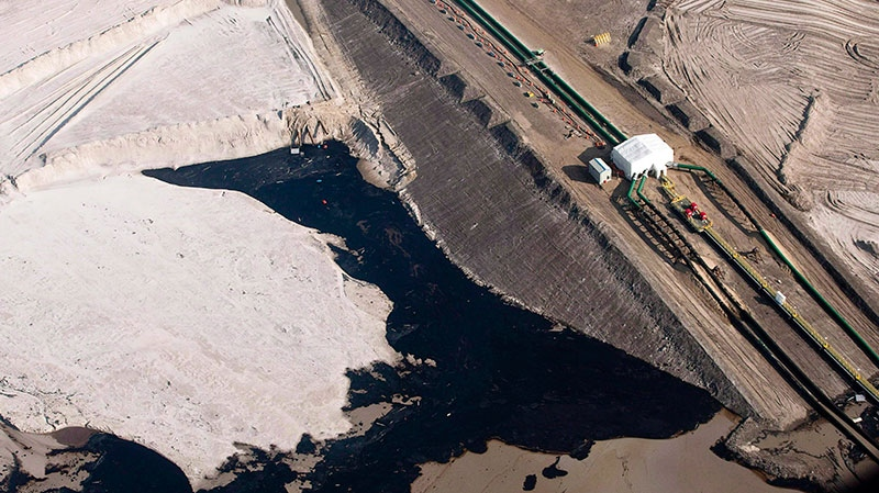 An oil sands facility seen from a helicopter near Fort McMurray, Alta., Tuesday, July 10, 2012. (Jeff McIntosh / THE CANADIAN PRESS)