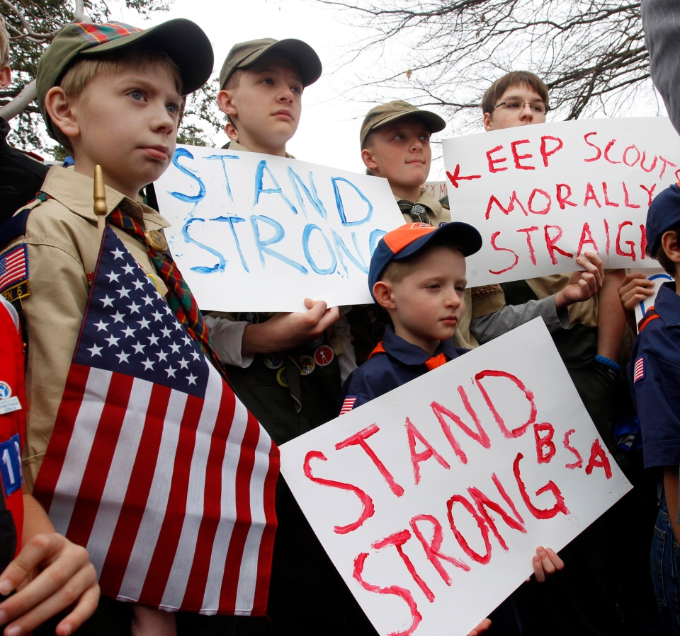 "Clockwise from left, Boy Scouts Eric Kusterer, Jacob Sorah, James Sorah, Micah Brownlee and Cub Scout John Sorah hold signs at the ""Save Our Scouts"" Prayer Vigil and Rally in front of the Boy Scouts of America National Headquarters in Irving, Texas, Wednesday, February 6, 2013. (AP / Richard Rodriguez)"